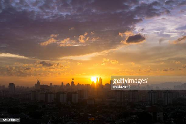 majestic view of sunset over downtown kuala lumpur, malaysia - shaifulzamri stock pictures, royalty-free photos & images