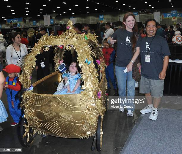Majic Wheelchair Builders Nikki Miyamoto and William Miyamoto with Princess Julissa attends day3 of Los Angeles Comic Con held at Los Angeles...