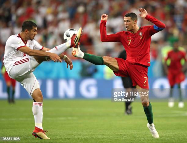 Majid Hosseini of Iran challenge for the ball with Cristiano Ronaldo of Portugal during the 2018 FIFA World Cup Russia group B match between Iran and...