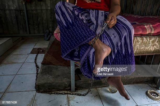 Majid sits inside in an indoor cage beside his house where his legs have been chained for six years by his parents because he suffers from mental...