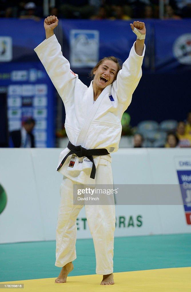 Majlinda Kelmendi of Kosovo celebrates after winning the u52kgs final by ippon during day 2 of the Rio World Judo Championships at the Gympasium Maracanazinho on August 27, 2013 in Rio de Janeiro, Brazil.