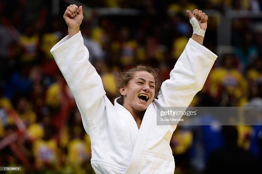 Majlinda Kelmendi of Kosovo celebrates the victory and gold medal in the -52 kg category during the World Judo Championships at Maracanazinho gymnasium on August 27, 2013 in Rio de Janeiro, Brazil.