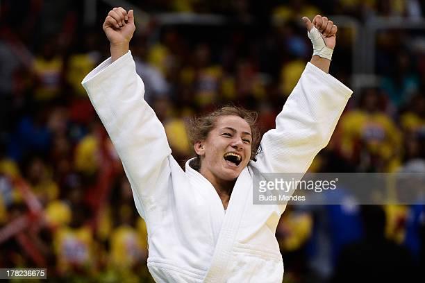 Majlinda Kelmendi of Kosovo celebrates the victory and gold medal in the 52 kg category during the World Judo Championships at Maracanazinho...