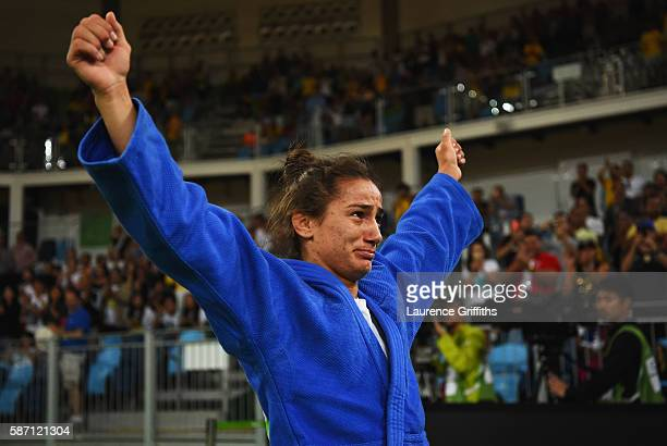 Majlinda Kelmendi of Kosovo shows her emotions as she celebrates winning the gold medal against Odette Giuffrida of Italy during the Women's 52kg...