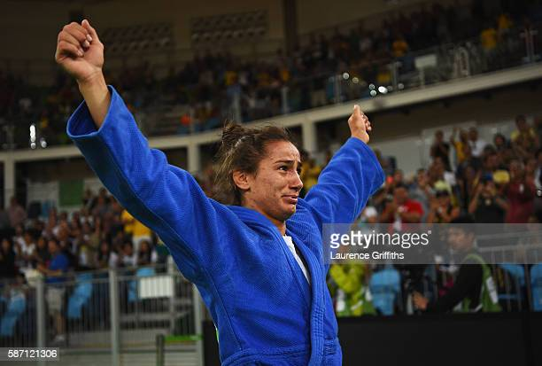 Majlinda Kelmendi of Kosovo shows her emotions as she celebrates winning the gold medal against Odette Giuffrida of Italy during the Women's 52kg...