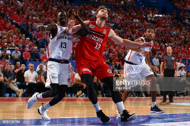 Majok Deng of the 36ers and Angus Brandt of the Wildcats contest for position during game two of the NBL Semi Final series between the Adelaide 36ers...