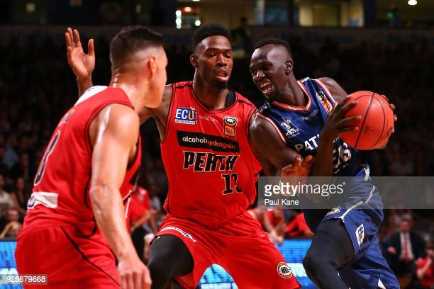 Majok Deng of the 36ers drives to the basket against Derek Cooke Jr of the Wildcats during game one of the Semi Final series between the Adelaide...
