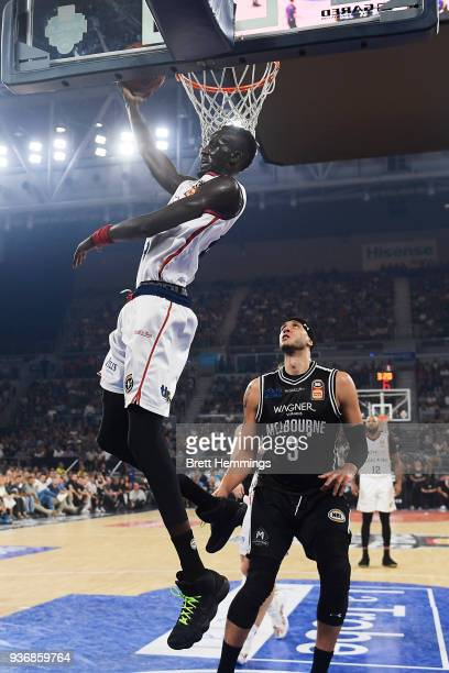 Majok Deng of the 36ers lays up a shot under pressure during game three of the Grand Final series between Melbourne United and the Adelaide 36ers at...