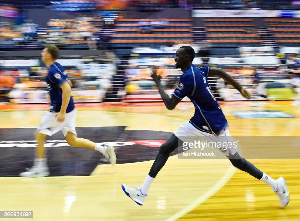 Majok Deng of the 36ers warms up before the start of the round four NBL match between the Cairns Taipans and the Adelaide 36ers at Cairns Convention...