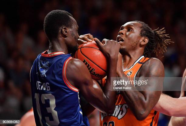 Majok Deng of the Adelaide 36ers competes for the ball with Jerry Evans Jnr of the Taipans during the round 14 NBL match between the Adelaide 36ers...