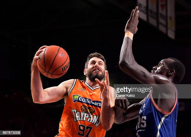 Majok Deng of the Adelaide 36ers defends Jarras Weeks of the Taipans during the round 11 NBL match between the Adelaide 36ers and the Cairns Taipans...