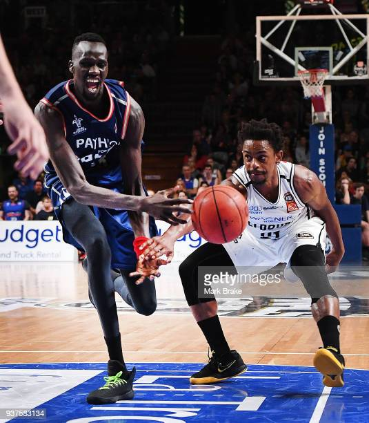 Majok Deng of the Adelaide 36ers fouled by Casper Ware of Melbourne United during game four of the NBL Grand Final series between the Adelaide 36ers...