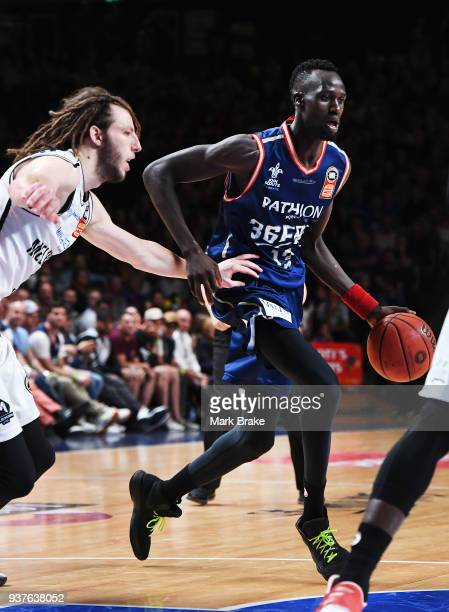 Majok Deng of the Adelaide 36ers pressured by Craig Moller of Melbourne United during game four of the NBL Grand Final series between the Adelaide...