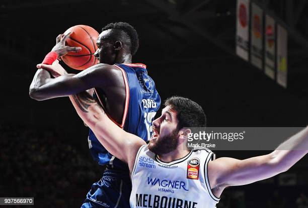 Majok Deng of the Adelaide 36ers steals a rebound off Toni SmithMilner of Melbourne United during game four of the NBL Grand Final series between the...