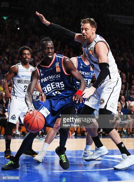 Majok Deng of the Adelaide 36ers takes David Andersen of Melbourne United during game four of the NBL Grand Final series between the Adelaide 36ers...