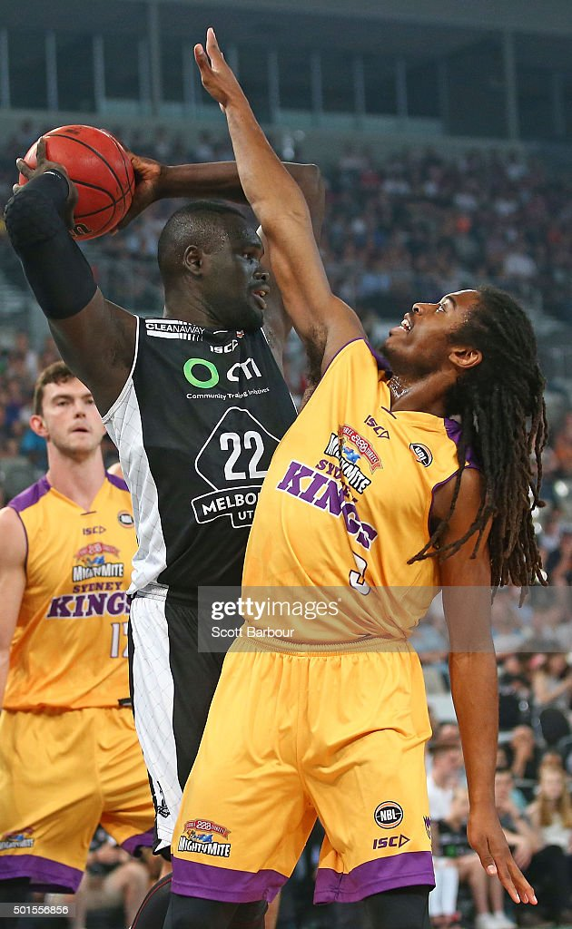 Majok Majok of Melbourne United and Marcus Thornton of the Sydney Kings compete for the ball during the round 11 NBL match between Melbourne United and Sydney Kings at Hisense Arena on December 16, 2015 in Melbourne, Australia.
