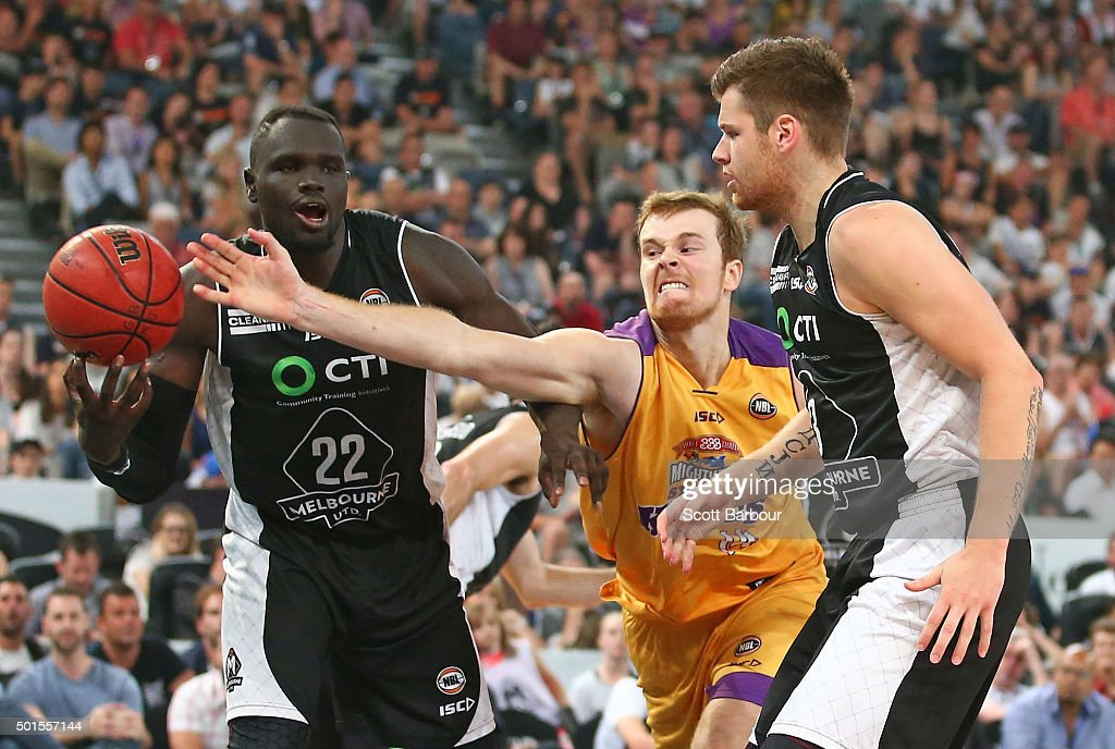 Majok Majok of Melbourne United and Tom Garlepp of the Sydney Kings compete for the ball during the round 11 NBL match between Melbourne United and Sydney Kings at Hisense Arena on December 16, 2015 in Melbourne, Australia.
