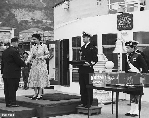 Major A D Firth MBE receives the Military Cross from Queen Elizabeth II on the promenade deck of the royal yacht Britannia circa 1960 The Queen...