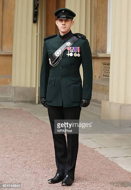 Major Andrew Todd of The Royal Gurkha Rifles with his MBE which he received from the Prince of Wales during an Investiture ceremony at Buckingham...