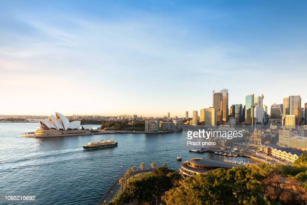 major architecture landmarks of the city of sydney and australia around sydney harbor in elevated aerial view in warm smooth sunlight at the morning. - opernhaus stock-fotos und bilder