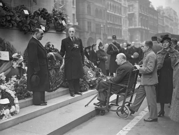 Major Ben Jack Brunel Cohen aka Jack Cohen National Treasurer for the British Legion watches Jack White VC and Leonard Keysor VC place their wreaths...