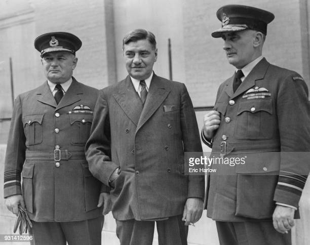 Major Charles Gavan Power MC the Canadian Defence Minister arrives at the Canadian headquarters in London with Air Marshal Lloyd Samuel Breadner and...