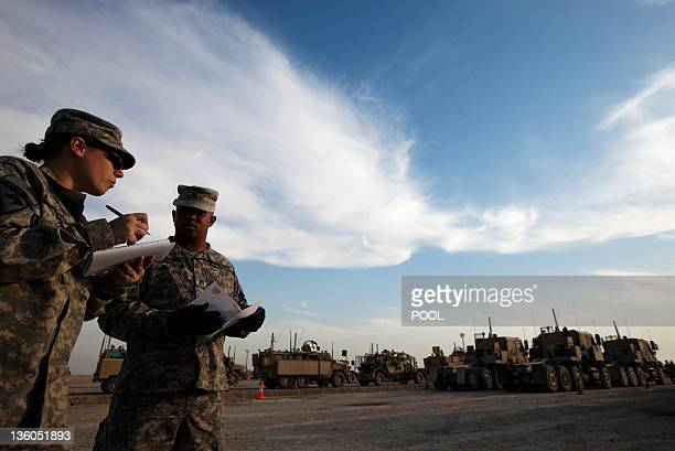 US Major Christina Lewis and Staff Sergeant Derrick Williams of the 3rd Brigade Combat Team 1st Cavalry Division take inventory of Mine Resistant...