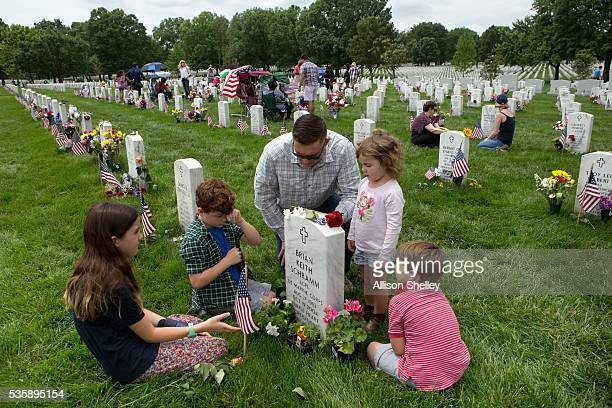 Major Clint Kappel and his children left to right Reeder Hayes Amelia and Weiler pay respects to Brian Keith Schramm in Section 60 the burial ground...