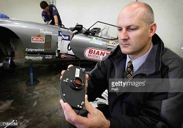 O'CONNOR AUSTRALIA SEPTEMBER 11 Major crash investigation section officer Senior Constable Alun Mills inspects the 'black box' recorder which was...