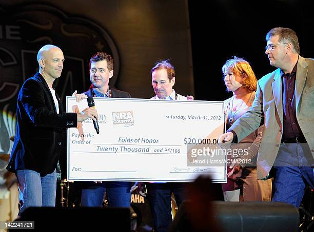 Major Dan Rooney USAF ACM boardmembers Ken Robold Butch Waugh and Sarah Trahearn and CEO for the Academy of Country Music Bob Romeo speak onstage at...