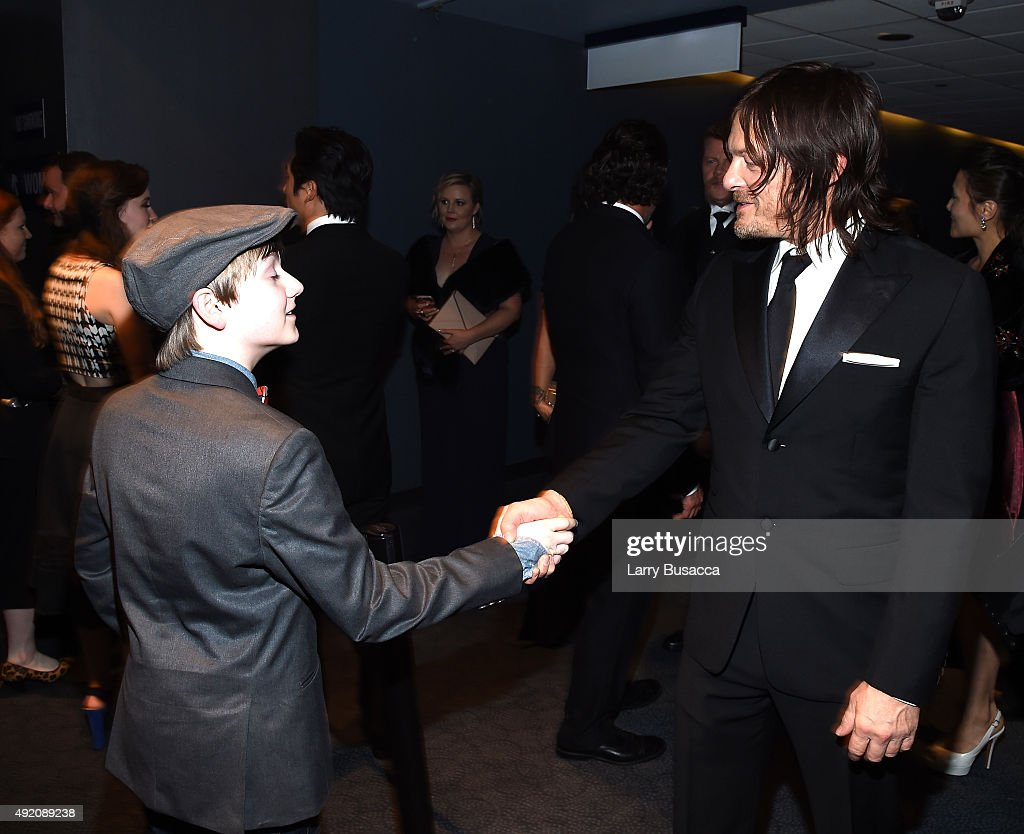 Major Dodson and Norman Reedus attend AMC's 'The Walking Dead' Season 6 Fan Premiere Event 2015 at Madison Square Garden on October 9, 2015 in New York City.