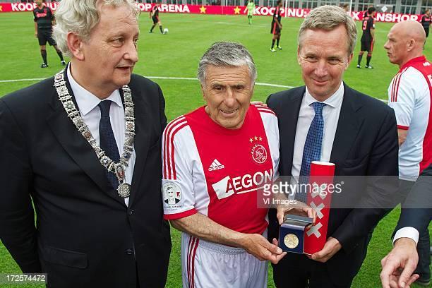 Major Eberhard van der Laan of Amsterdam, Sjaak Swart with medal of honour, alderman Eric van der Burg of Amsterdam during the Sjaak Swart 75th...