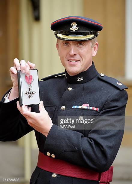 Major Edward Colver from OC Corunna Company 3rd Bn The Yorkshire Regiment holds his MBE medal after he received the award from Prince Charles Prince...