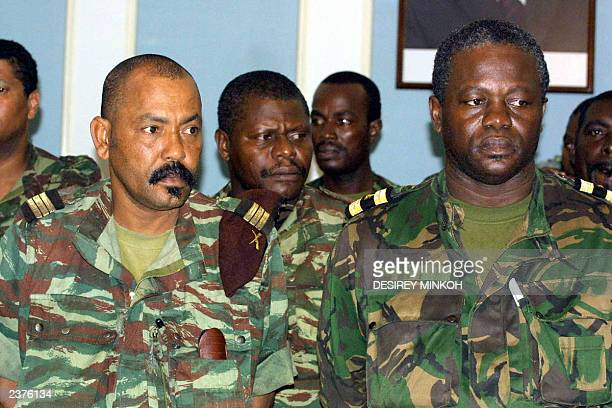 Major Fernando Pereira coup leader and Arlesio Costa head of 'Buffalo Battalion' stand in the presidents residence 23 July 2003 before a meeting with...
