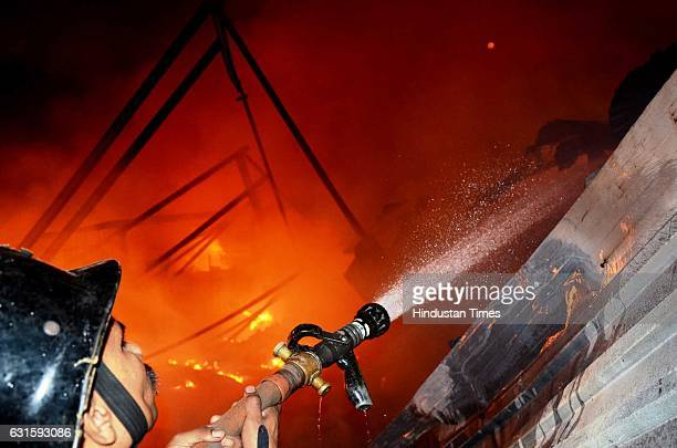 Major fire breaks out at a transit camp in Mandala area at Mankhurd, on January 12, 2017 in Mumbai, India. The area is home to a massive scrap market...