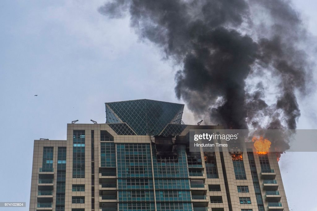 A major fire breaks out at BeauMonde Towers at Prabhadevi, on June 13, 2018 in Mumbai, India. Two firemen had to be hospitalised after a major blaze charred the top three floors of a 33-storey residential high rise. No other casualties were reported at the BeauMonde Towers, where Bollywood actor Deepika Padukone also owns a 26th floor apartment. As many as 95 people were safely evacuated from the building soon after the fire alarm went off.