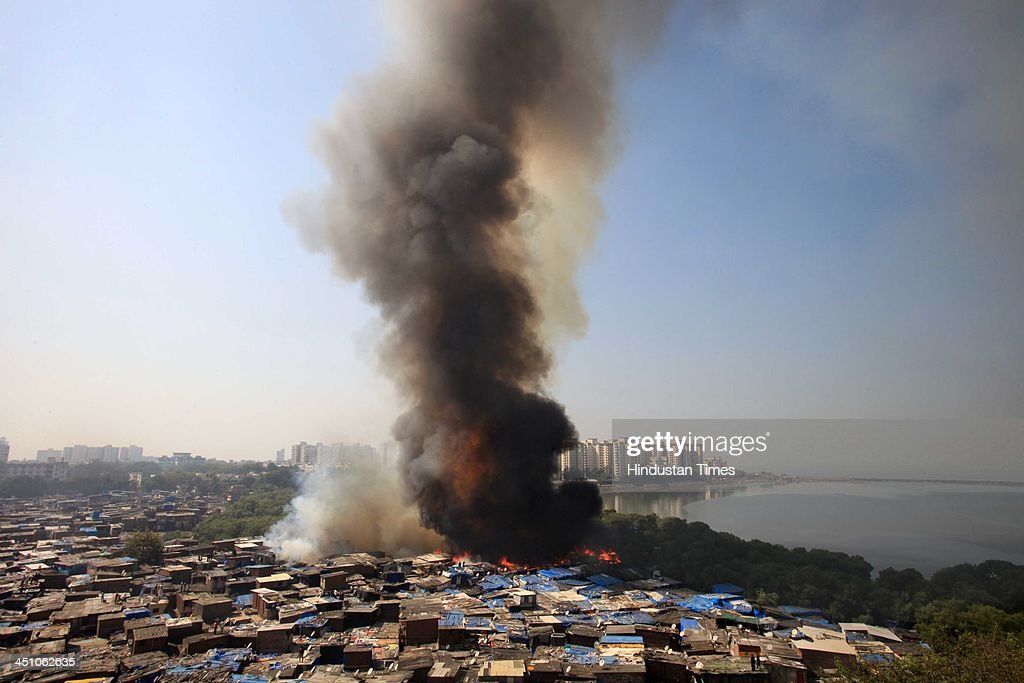 A major fire broke out in Ambedkar Nagar slum at Cuffe Parade in Mumbai, India on Thursday, November 21, 2013.Several huts were gutted in a fire that broke out in the settlement
