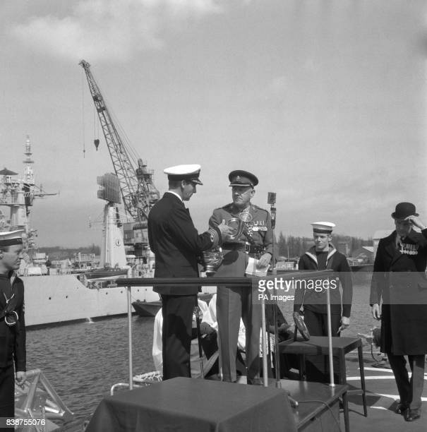 Major General CH Tarver Deputy Colonel presents a silver bugle to Captain Iwan Geoffrey Raikes of the guided missile destroyer Kent on behalf of the...
