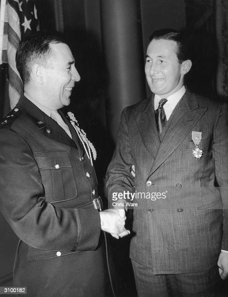 Major General Clayton Bissell the American Military Attache congratulates British Captain Roy Farran DSO MC after presenting him with the Legion of...