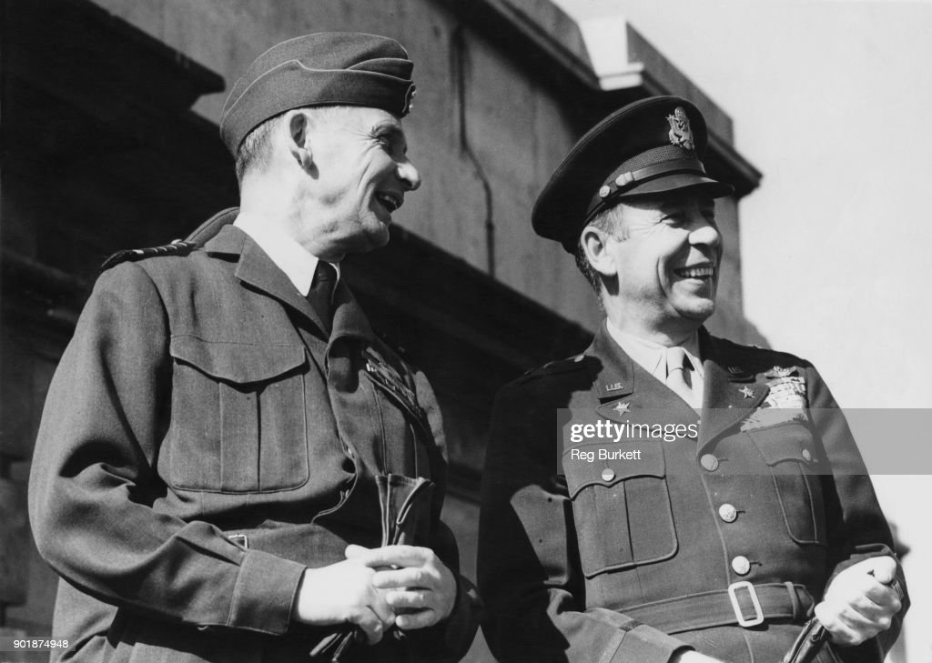 US Major General Clayton Lawrence Bissell (1896 - 1972, right), and Lord Arthur Tedder (1890 - 1967, left), Marshal of the Royal Air Force, watch a Battle of Britain commemorative fly-past from the roof of the Air Ministry in London, 15th September 1947.