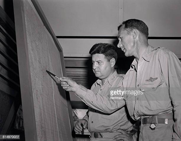 Major General Curtis E LeMay Commanding General points out a detail on the map to his Chief of Staff Brig General A W Kissner of Washington D C as...
