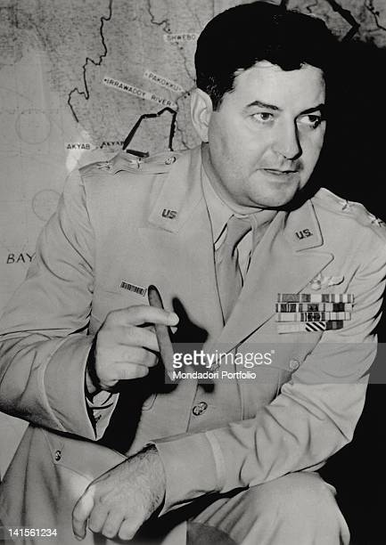Major General Curtis LeMay commander of US bombers operating in the Pacific smoking a cigar at the Pentagon Washington July 1945