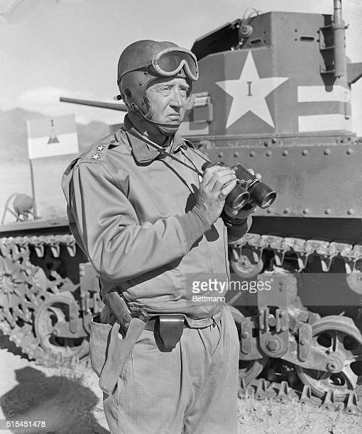 Major General George S. Patton, Jr., commanding officer of First Armored corps, is shown watching, with binoculars, M3 fight tanks on maneuvers. BPA2