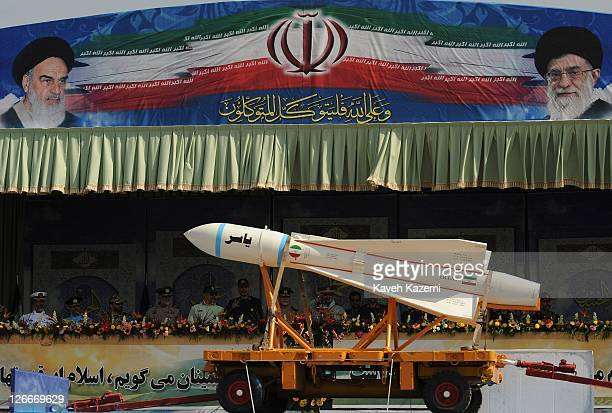 Major General Hassan Firoozabadi alongside other military commanders observes ballistic missiles during a parade commemorating the 31st anniversary...