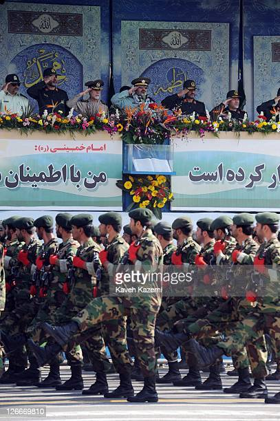 Major General Hassan Firoozabadi salutes alongside other military commanders as they observe a parade commemorating the 31st anniversary of IranIraq...
