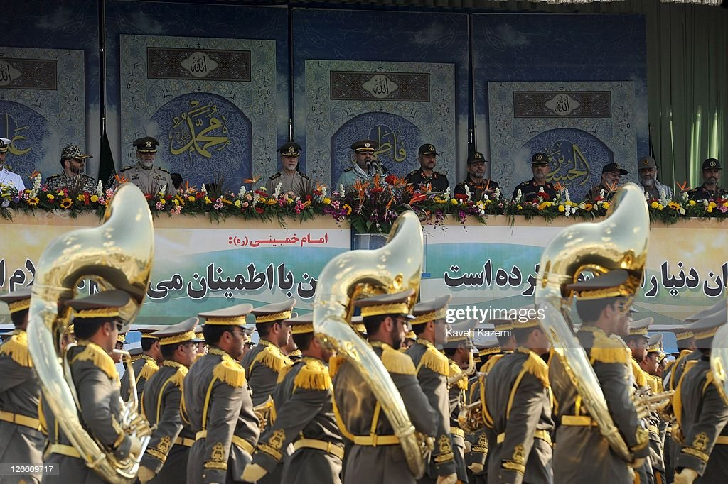 Major General Hassan Firoozabadi (C) stands alongside other military commanders as they observe a parade commemorating the 31st anniversary of Iran-Iraq war on September 22, 2011 in Tehran, Iran. Iran is holding military parades in Tehran and other parts of the country on the first day of the Sacred Defence Week. Tehran's parade began to the north of Imam Khomeini's mausoleum providing the army, Islamic Revolution Guards Corps, Law Enforcement Force and Basij with an opportunity to display their state of military preparedness, in which armaments and indigenously built military equipment including Shahab missiles, unmanned aircrafts, Zulfaqar tanks, and a variety of rapid fire machine guns were showcased.
