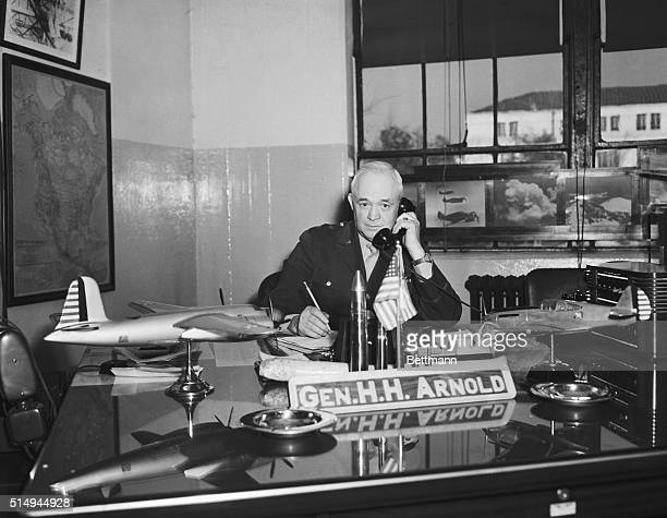 Major General Henry H. Arnold, Chief of the Air Corps, sits in his office at the War Department, December 10, receiving telephonic reports on the...