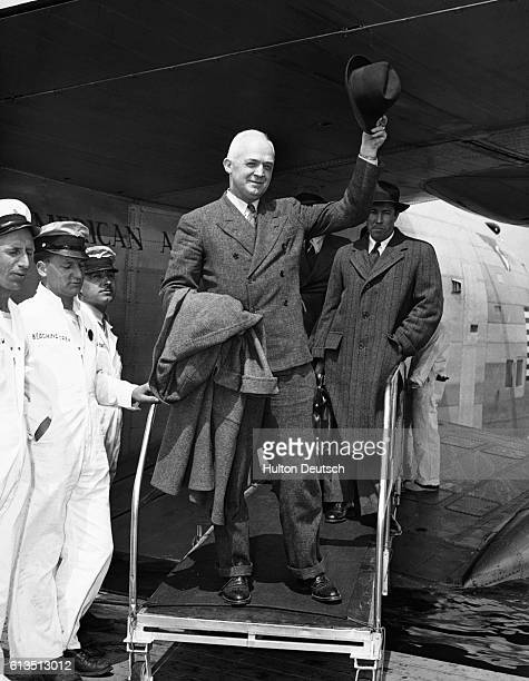 Major General Henry H. Arnold, the chief of the United States Army Air Corps, disembarks from a Pan American yankee clipper on arrival at Laguardia...