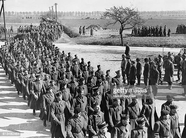 Major General Henry Twaddle, commander of the 95th Infantry Division, US 9th Army, held a Liberation Parade at the prison camp for French officers at...