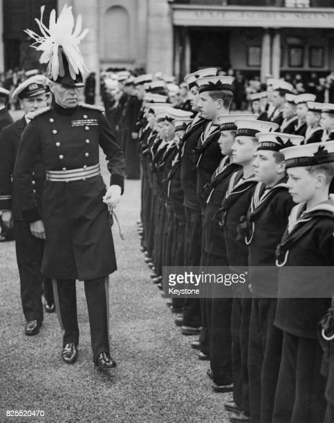 Major General Hubert Huddleston Lieutenant Governor of the Royal Hospital Chelsea inspects a group of young sea cadets at a mass parade of sea army...